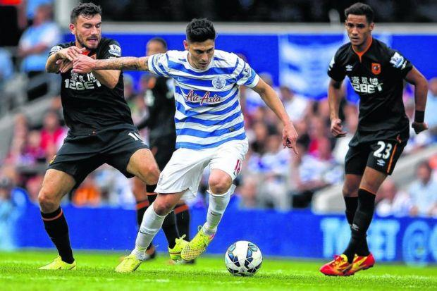 Robert Snodgrass, left, in action against QPR shortly before suffering his injury. Picture: Getty
