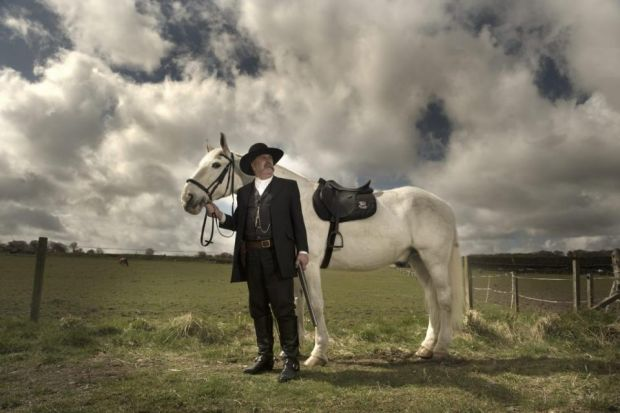 Grant completes his look with a cowboy's essential companion - a trusty steed - at Tower Farm Riding Stables in Edinburgh