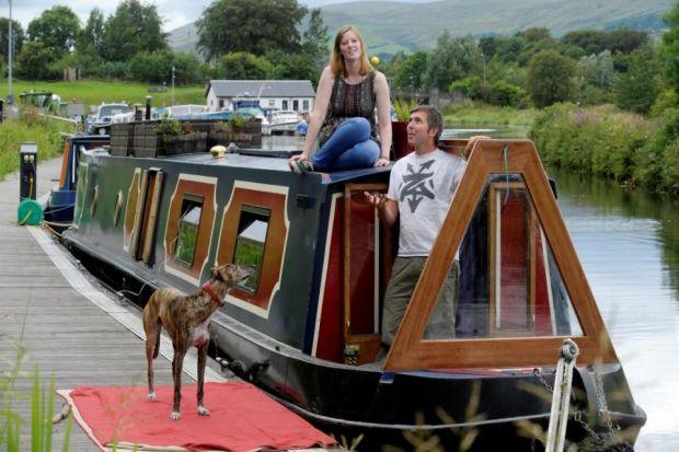 Main picture, Iain Withers, partner Sarah and their dog, Twizzle, live on their boat at Auchinstarry, Kilsyth. Above, a boater enjoys a trip on the Forth and Clyde Canal under the Erskine Bridge