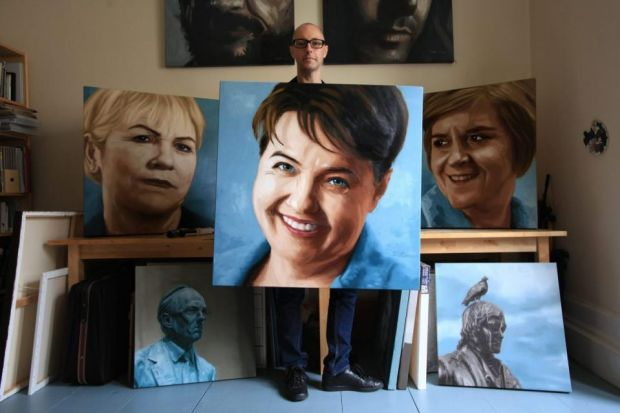 Iain Campbell with his portraits of, from left, Johann Lamont, Ruth Davidson and Nicola Sturgeon