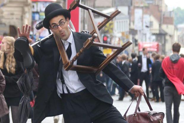 PACKING UP: A street performer carries off all his props as the Fringe draws to a close. Picture: Gordon Terris