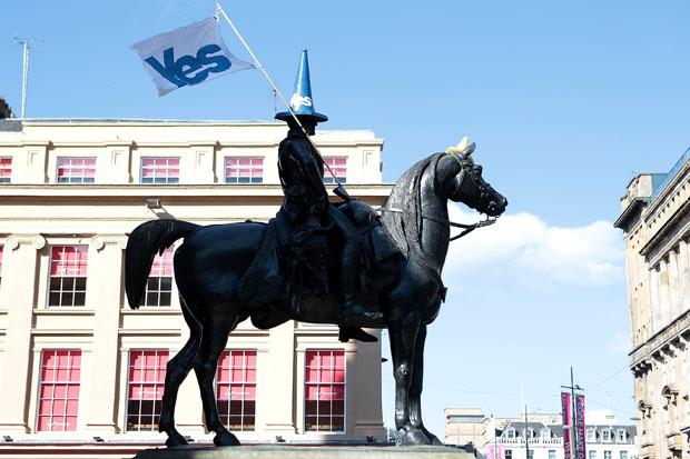 The Duke of Wellington's statue in Glasgow has been adorned with a Yes Scotland traffic cone and flag