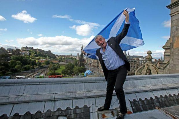 SHOUTING IT FROM THE ROOFTOPS: Ryanair boss Michael O'Leary flies the flag in Edinburgh as he announces new flights. Picture: Gordon Terris