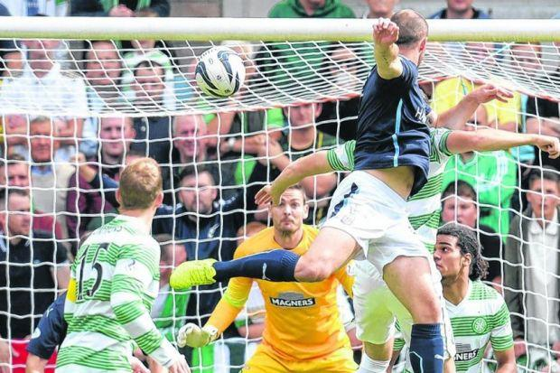 James McPake rises to head Dundee in front with a minute on the clock. Picture: SNS