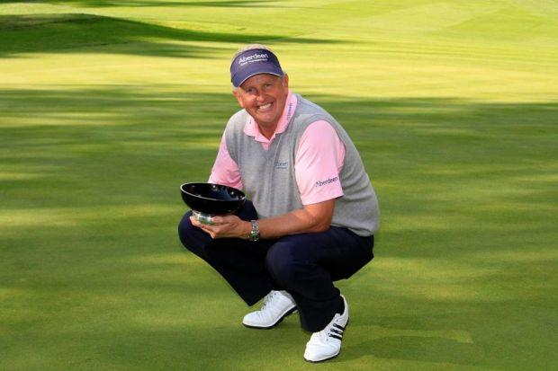 Colin Montgomerie is all smiles with the Travis Perkins Masters trophy