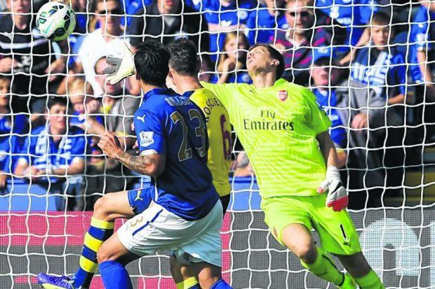 Out of reach: Leonardo Ulloa watches  as his effort evades Wojciech Szczesny  to give Leicester  a deserved draw with Arsenal. Picture: Getty