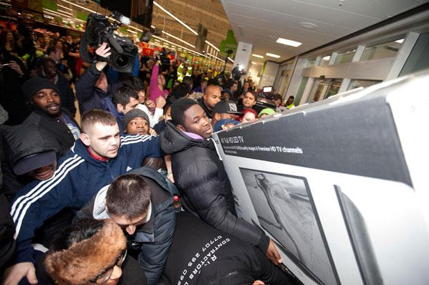 Shoppers snap up bargains at a supermarket in Wembley, London. PA.
