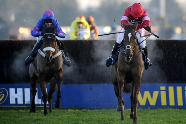 Noel Fehily on Silviniaco Conti (right) jumps over the last ahead of Cue Card to win the King George last yearPhotograph: Getty