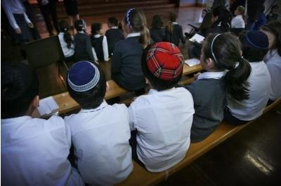 Pupils at Calderwood Lodge School, Scotland's only Jewish primary, which will soon share a campus with Catholic pupils.