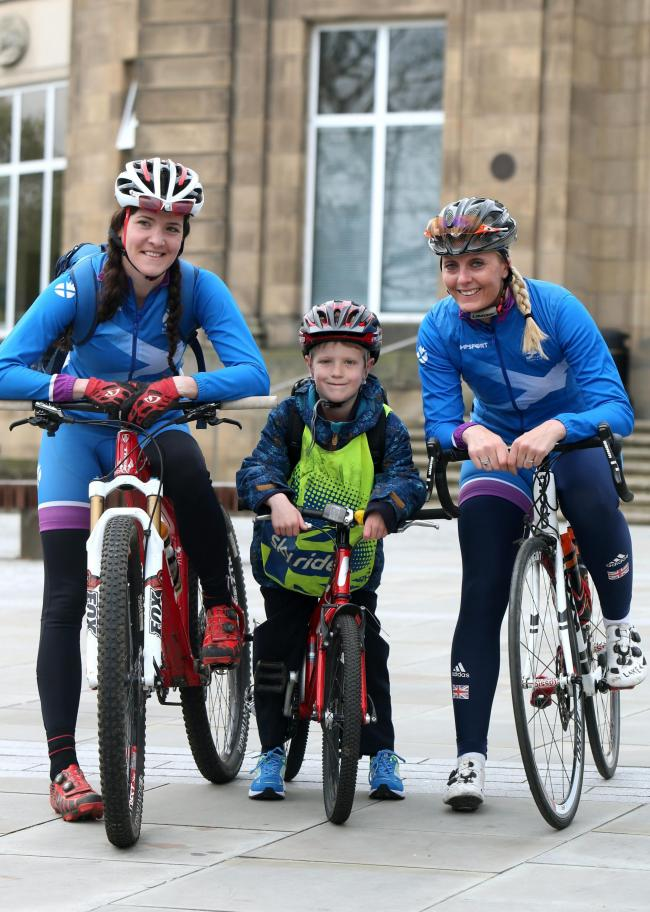 Ben Wilson, aged eight, with mountain biker Kerry MacPhee, left, and double Commonwealth silver-medallist Louise Haston at the launch of the 2015 Edinburgh Festival of Cycling Photograph: Gordon Terris