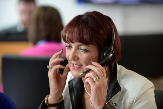 Education Secretary Angela Constance visits a national pupil helpline before the publication of results for Scottish school qualifications.