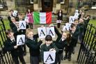 Pupils from St Aloysius' College in Glasgow celebrate with their teachers after achieving A passes in their Intermediate 1 Italian language classes.
