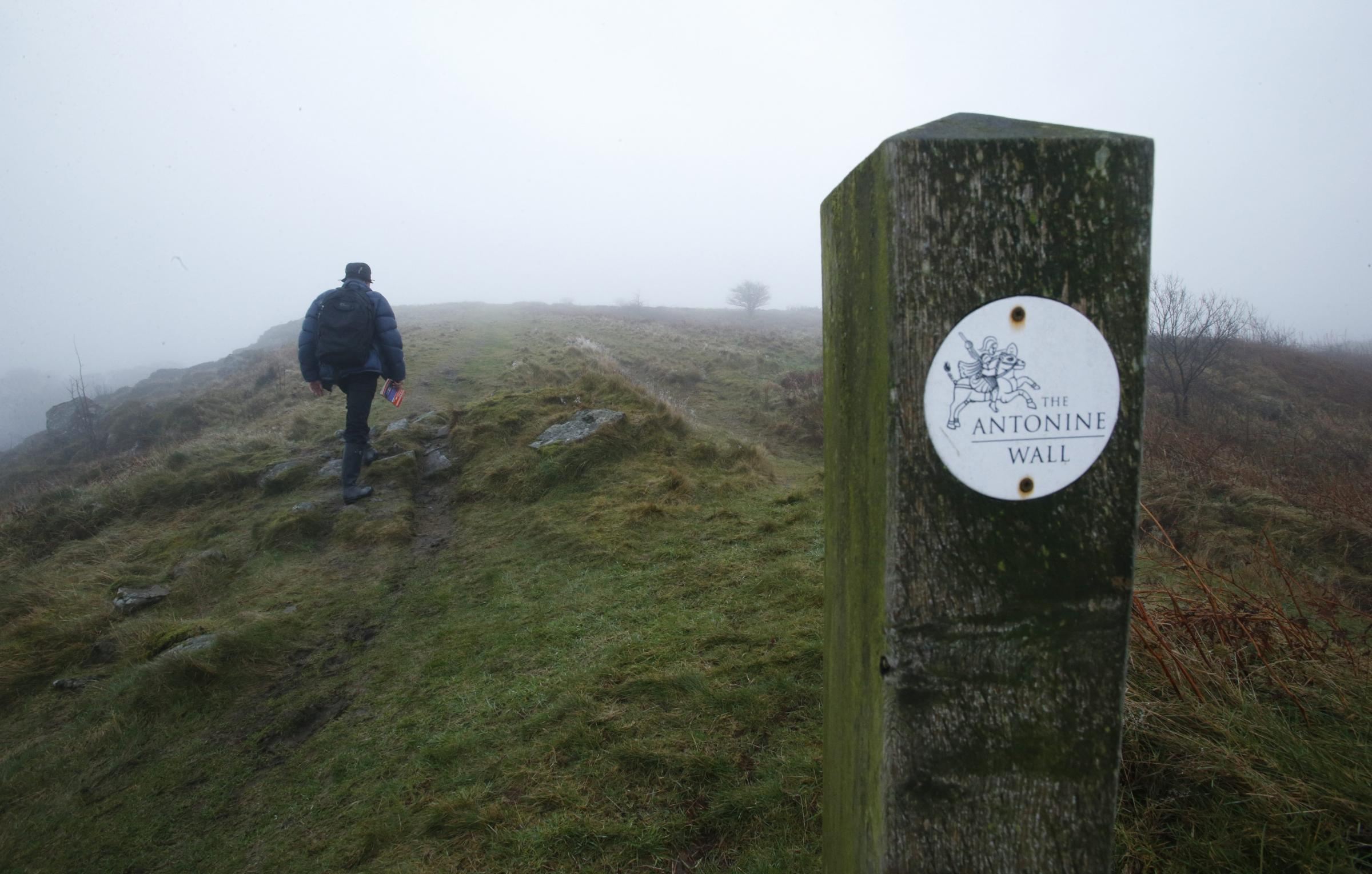 A walker pictured on the Antonine Wall walk on Croy Hill, North Lanarkshire. The Antonine wall walk is part of the new John Muir Way, a new long distance path that runs from Dunbar in East Lothian to Helensburgh. The John Muir way opens in April 2014.