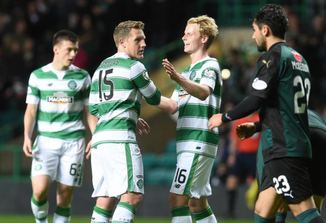 Kris Commons (left) celebrates after scoring the opening goal of Celtic's win over Raith Rovers