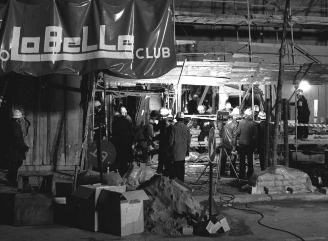 "Firemen inspect the scene of the bomb attack at the discotheque ""La Belle"" in West Berlin in this April 5, 1986"
