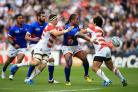 Alesana Tuilagi of Samoa passes under pressure from the Japanese defence. Picture: PA
