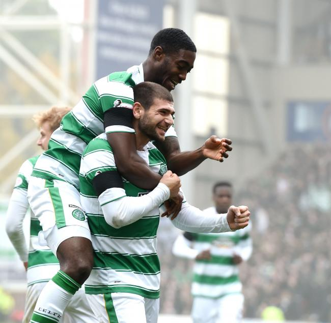 Tyler Blackett celebrates with striker Nadir Ciftci after the Turk opens the scoring against Motherwell on Saturday. Picture: SNS
