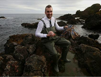 MAKING WAVES: Kevin Scott, St Abbs Marine Station Manager, with a female blue lobster and sea urchin as he celebrates the joint marine research project.