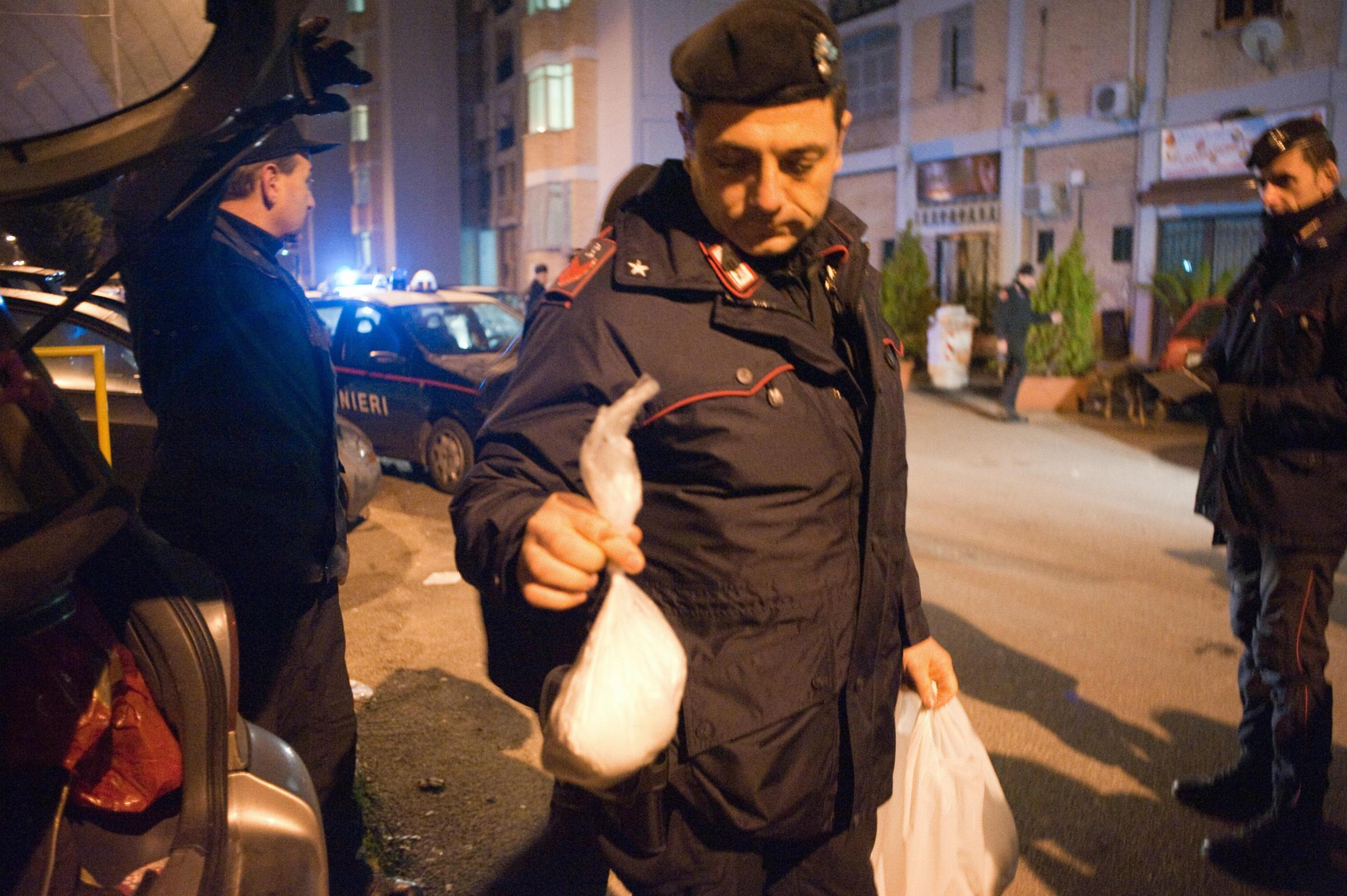 An Italian policeman holds a bag full of cocaine which was found in a car in the Scampia area of  Naples