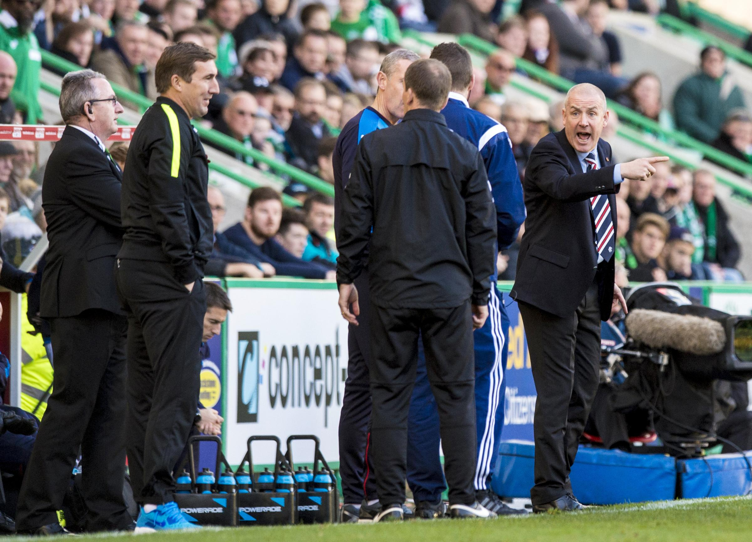 MIND YOUR OWN BUSINESS: Rangers manager Mark Warburton (right) has been irked by the latest claims made by Hibernian rival Alan Stubbs about their respective budgets