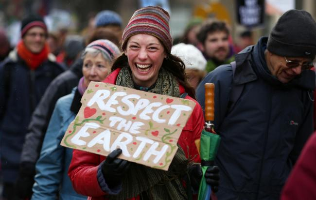 Protesters march through Edinburgh's city centre to call for tougher action to tackle climate change. David Cheskin/PA Wire