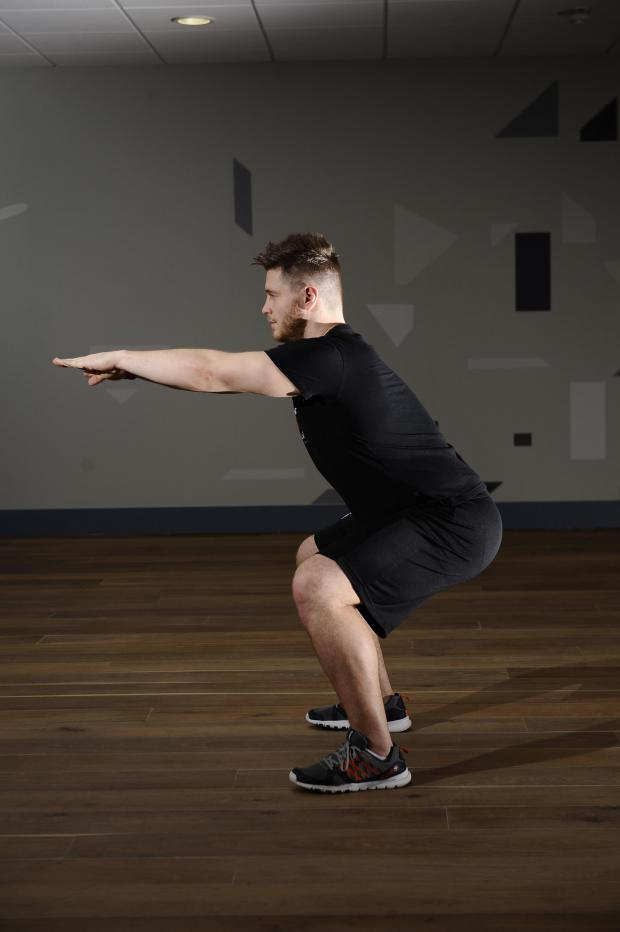 HeraldScotland: Evening Times  blogger and fitness instructor Jordan McCulloch demonstrates a squat. Picture: Jamie Simpson