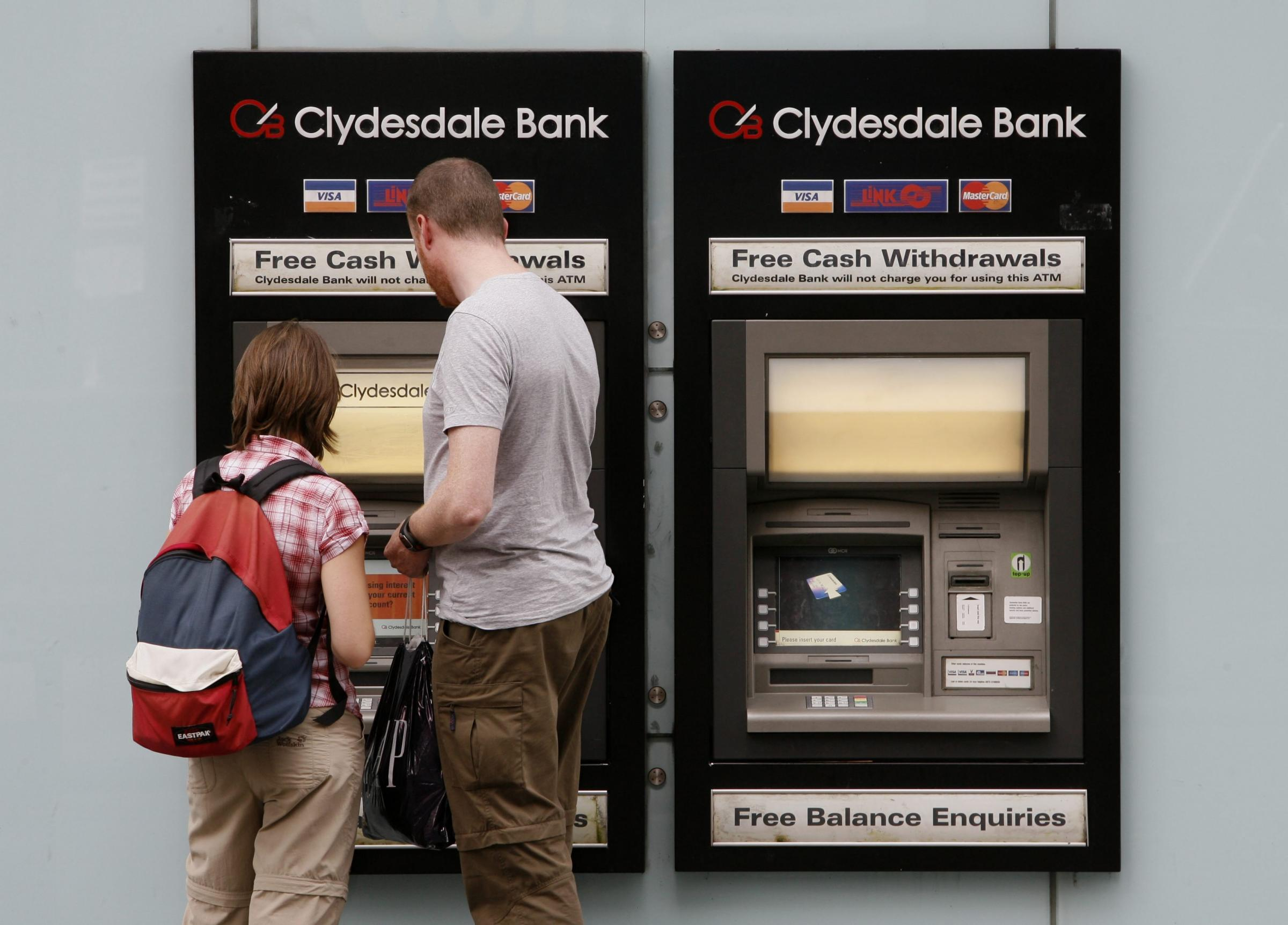 A couple use a Clydesdale Bank cash machine at the Clydesdale Bank headquarters in Glasgow. Picture: Colin Mearns.