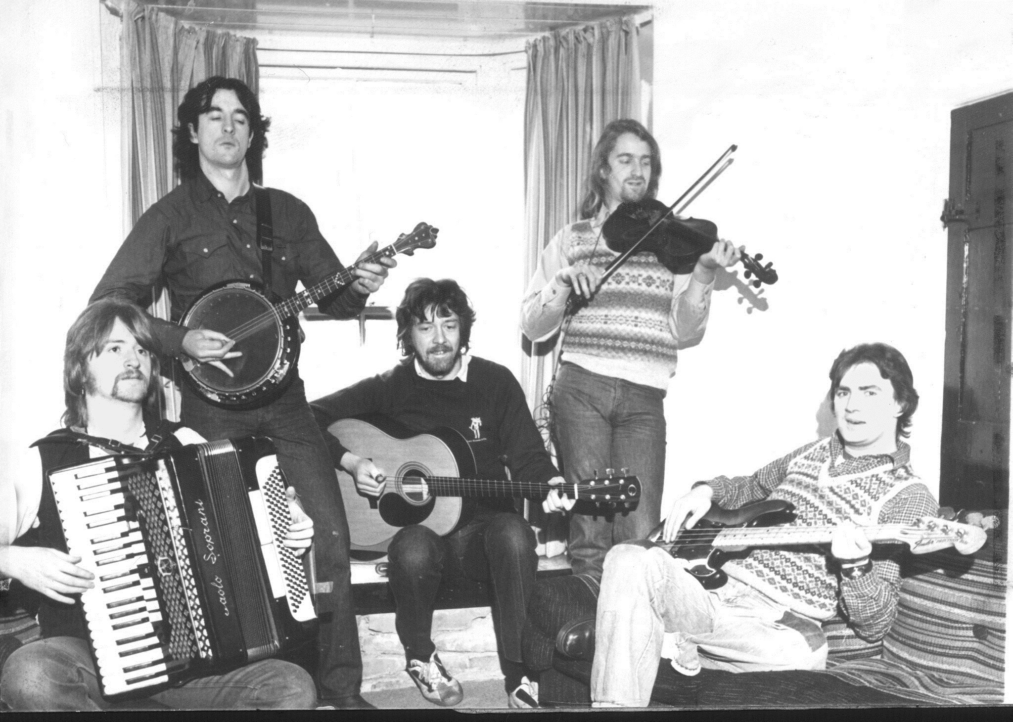 Andy M Stewart, top left, with the other members of Silly Wizard