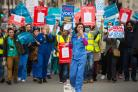 "Junior doctors and their supporters stage a ""masked march"" protest in London over pay and conditions, the third time they have taken to the streets in protest at the Government's proposals. (PA)"
