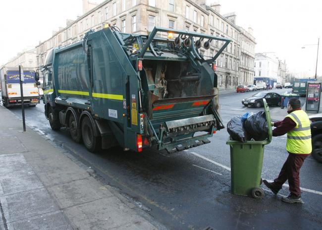 Refuse collectors at work.