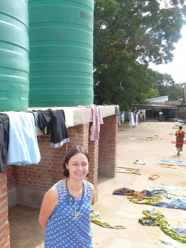 Dr Louisa Pollock in front of one of the water tanks