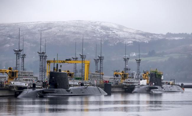 Astute-class submarines HMS Artful (left) and HMS Astute (right), at HM Naval Base Clyde, also known as Faslane. PRESS ASSOCIATION Photo. Picture date: Wednesday January 20, 2016. See PA story DEFENCE Trident. Photo credit should read: Danny Lawson/PA Wir