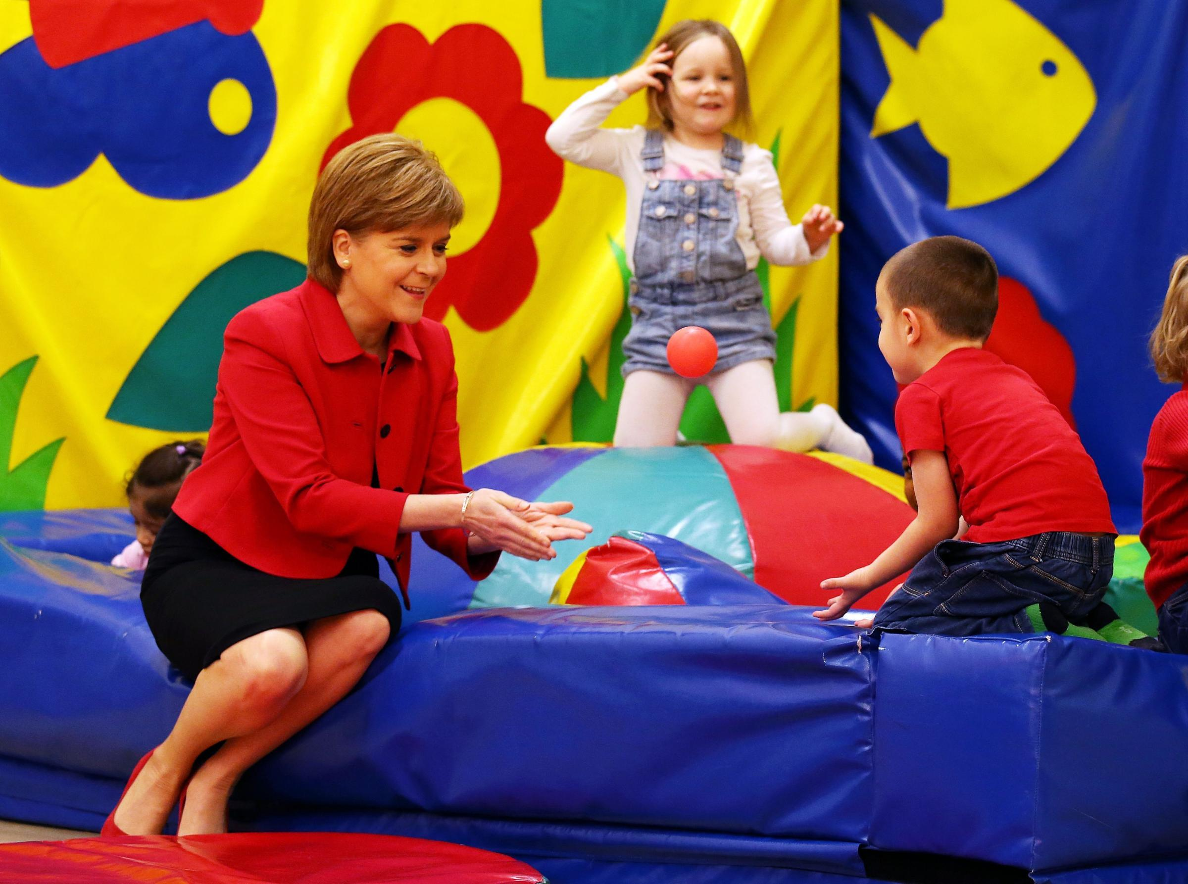 First Minister Nicola Sturgeon plays with children during a visit to North Edinburgh Childcare