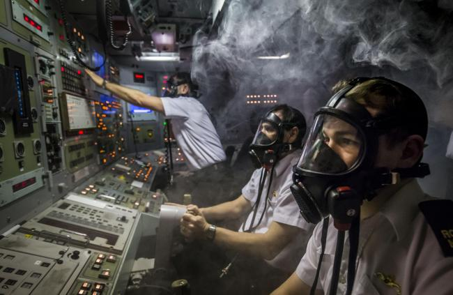 Members of the Royal Navy respond to a simulated fire in a Vanguard-class submarine control room simulator at a training facility in HM Naval Base Clyde, also known as Faslane, ahead of a visit by Defence Secretary Michael Fallon. PRESS ASSOCIATION Photo.
