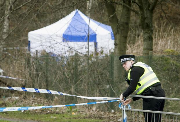 HeraldScotland: A policeman at the scene where the body of Paige Doherty was found