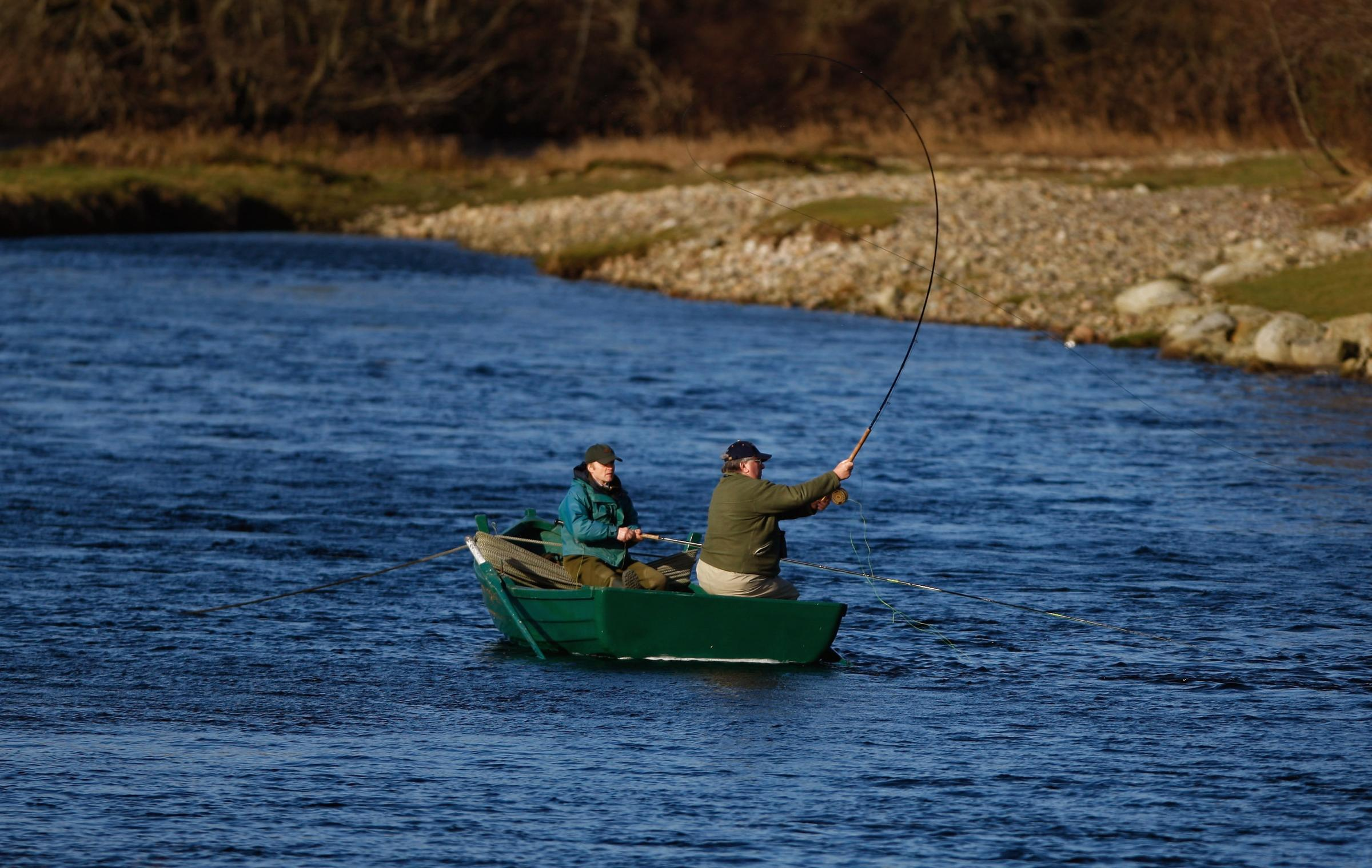 BANCHORY, SCOTLAND - FEBRUARY 25:  A fisherman casts on the lower Crathes beat on The River Dee on February 25, 2009 in Banchory, Scotland. Internationally renowned for its salmon fishing, bookings on the river are up 20% on last year despite the credit c