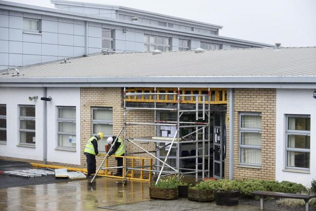 Workmen carry out repairs at Oxgangs Primary School in Edinburgh, Scotland, one of seventeen schools in Edinburgh closed due to building safety fears. Photo credit: Jane Barlow/PA Wire