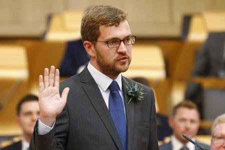 HeraldScotland: Oliver Mundell being sworn in.