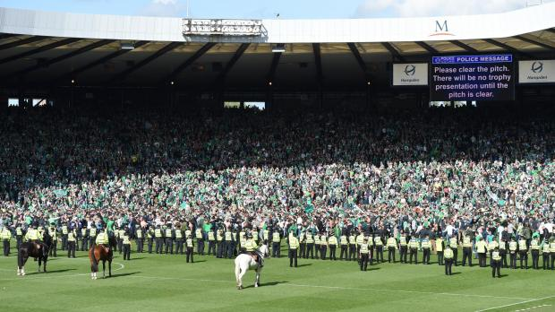 HeraldScotland: Police attempt to push back the Hibernian fans at Hampden