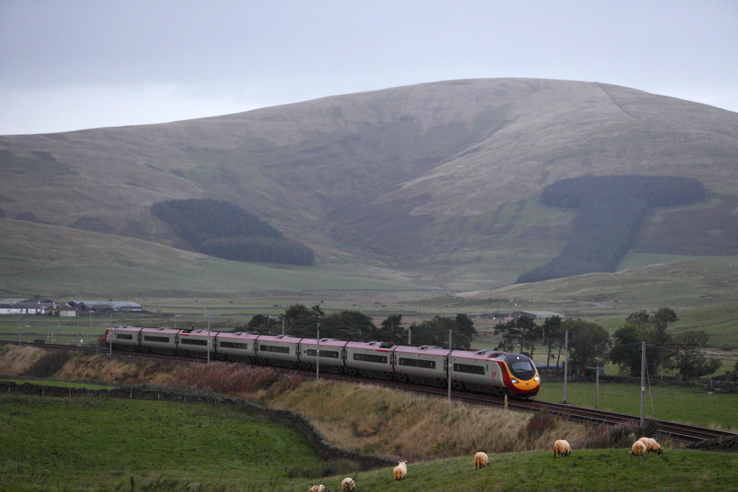 A Virgin Trains Pendolino train pictured on the West Coast Main line at Crawford, near Abington.Picture: Colin Mearns