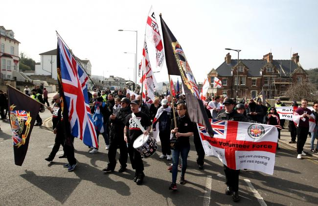 A group of far-right protesters march though Dover in Kent, the group are protesting against the arrival of immigrants; the Kent Anti-Racism Network have also organised a counter-demonstration.