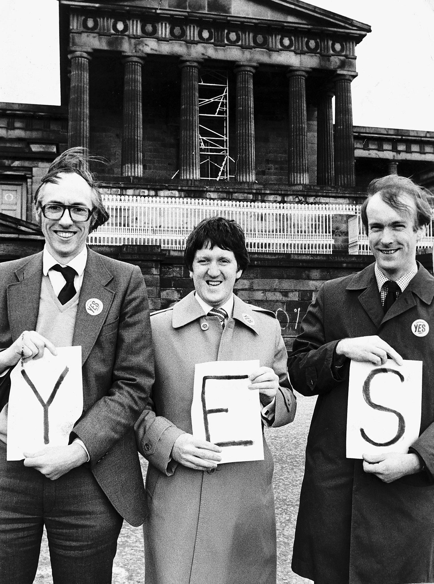 Donald Dewar, George Robertson and John Home Robertson standing outside the Royal High School Assembly building in Edinburgh campaigning for a Yes vote in the devolution referendum  of1979