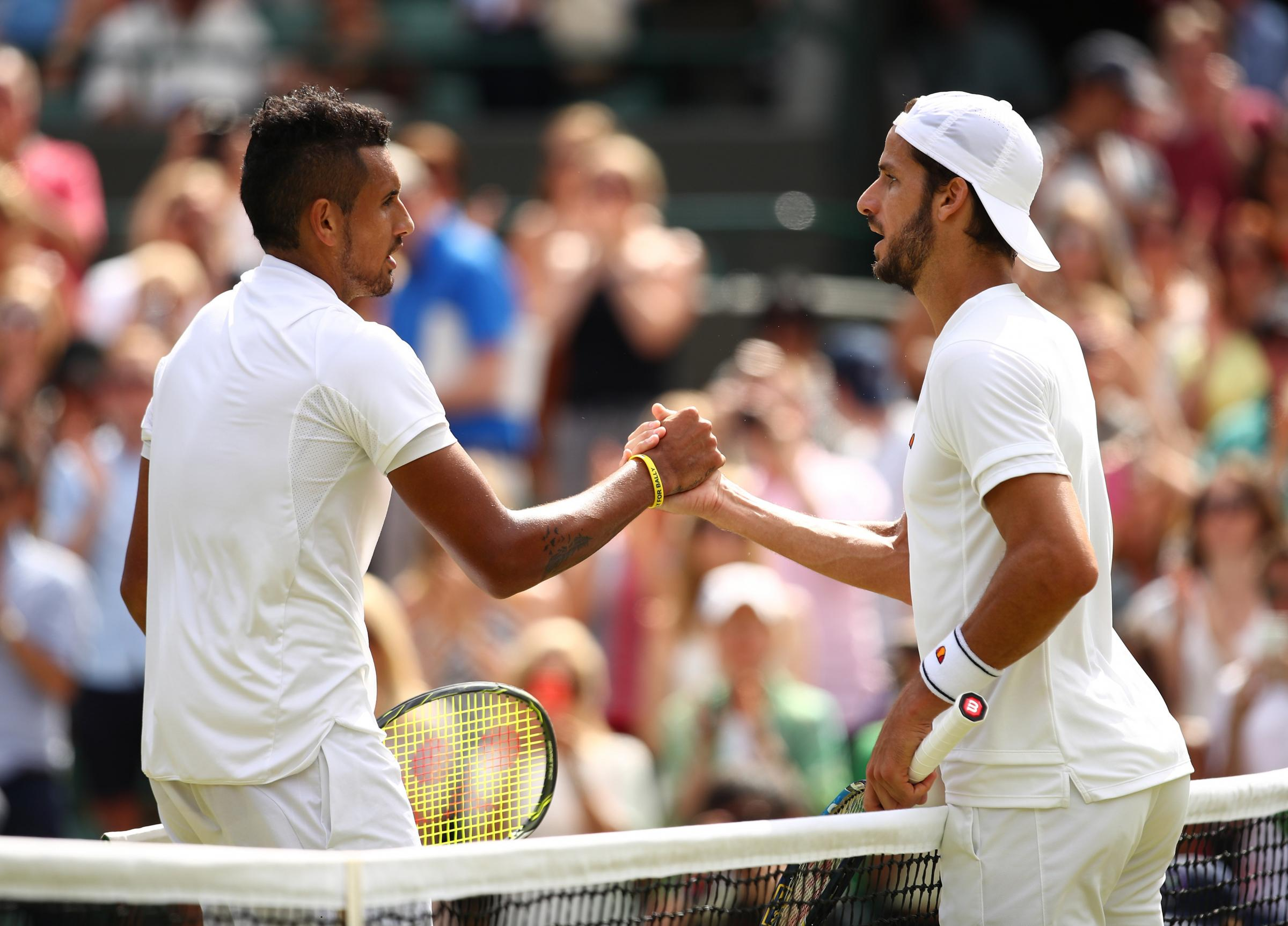 Nick Kyrgios (left) is congratulated by Feliciano Lopez after winning their Wimbledon singles match on People's Sunday yesterday. Picture: Getty