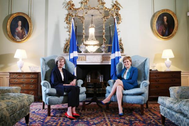HeraldScotland: EDINBURGH, SCOTLAND - JULY 15: British Prime Minister Theresa May (L) meets with First Minister Nicola Sturgeon at Bute House on July 15, 2016 in Edinburgh, Scotland. Prime Minister flew in for Brexit talks with the First Minister, and is expected to expr