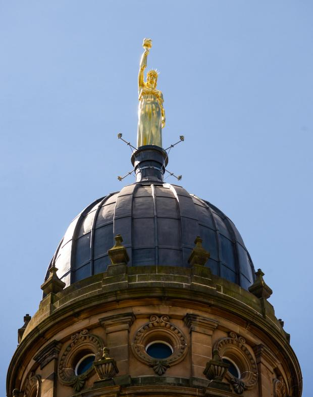 HeraldScotland: Light and Life statue on top of the Co-op building  Photo: Nick Ponty