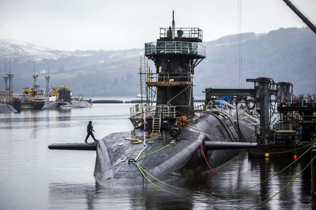 HeraldScotland: Vanguard-class submarine HMS Vigilant, one of the UK's four nuclear warhead-carrying submarines, at HM Naval Base Clyde, also known as Faslane. Picture Danny Lawson/PA Wire