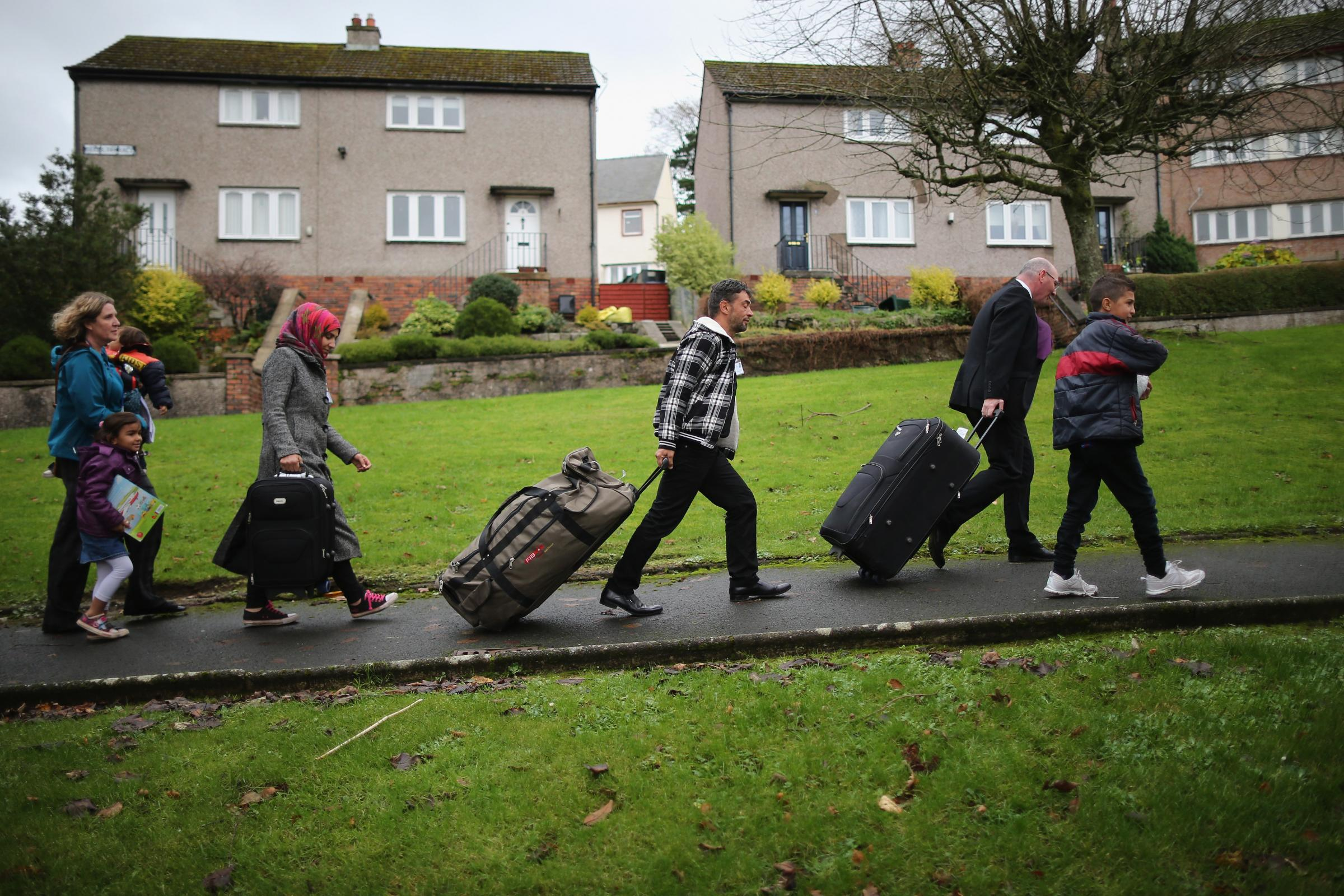Syrian refugee families arrive on the Isle of Bute on December 4 last year