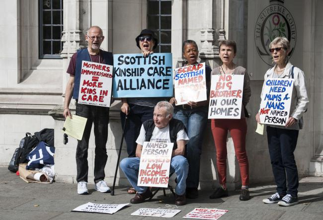 TAKING A STANCE: Protestors outside the Supreme Court in London yesterday after judges ruled against the Scottish Government's Named Person scheme. The scheme had been approved by Holyrood as part of the Children and Young People (Scotland) Act 2014.