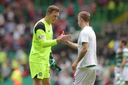 HeraldScotland: Celtic goalkeeper Dorus de Vries, left, shakes hands with Leigh Griffiths after the Aberdeen game on Saturday.