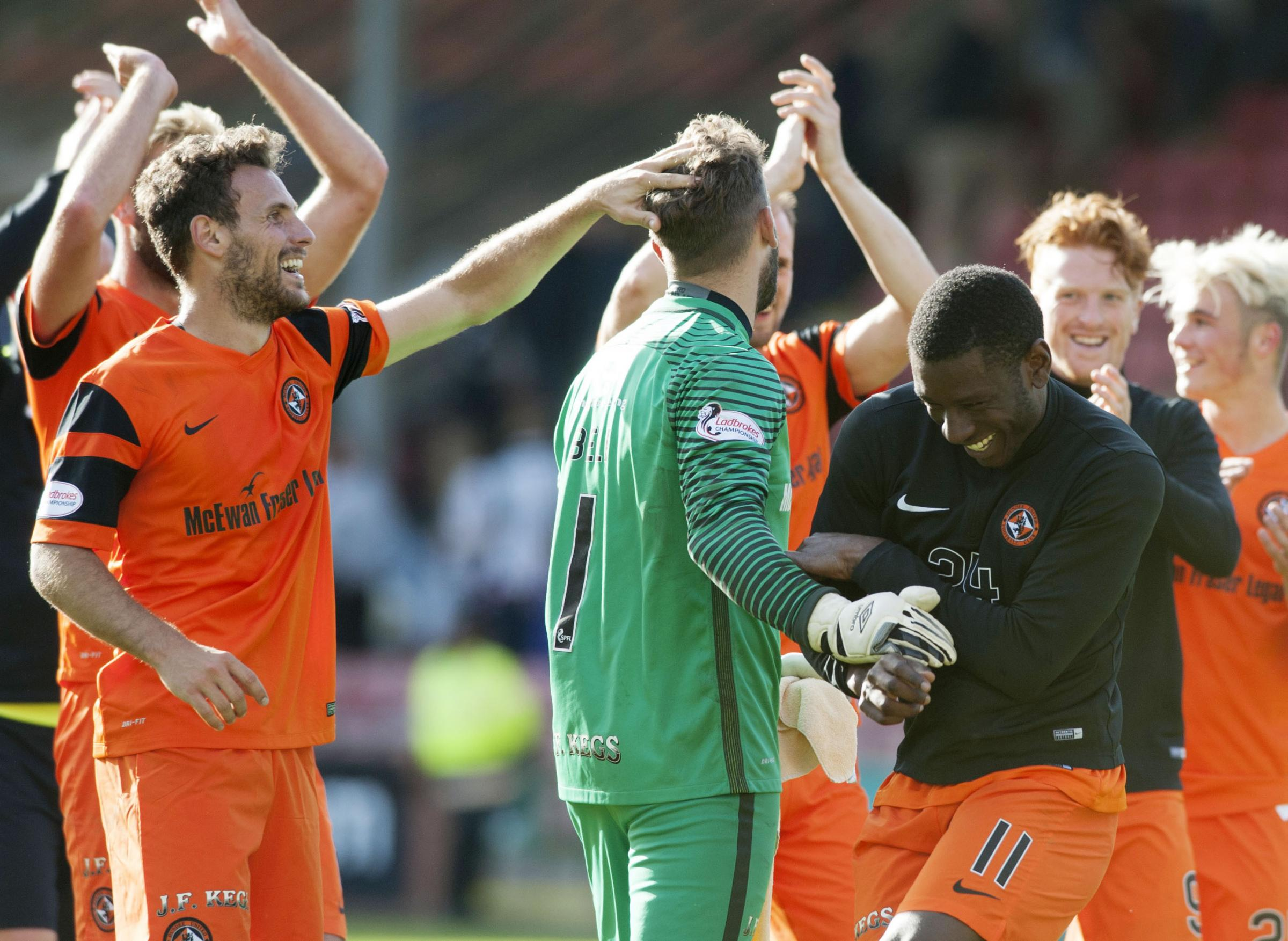 Dundee United goalkeeper Cammy Bell (centre) receives praise at full time having saved three penalties. Picture: SNS